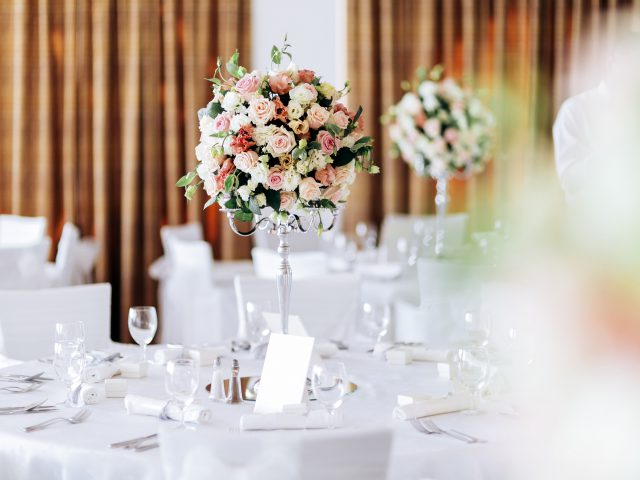 Beautiful wedding tables and roses in bouquet